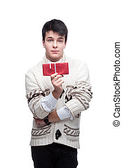 cute casual winter man holding christmas gift