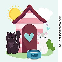 cute cats with house and canned fish in the grass