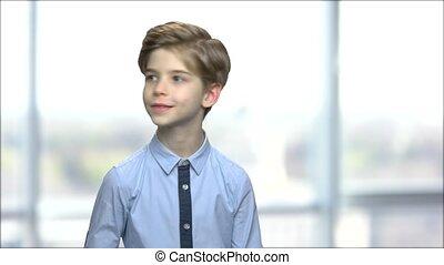 Cute caucasian boy looking around.