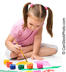 Cute cheerful child play with paints