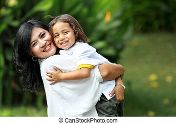 Cute cheerful child with mother