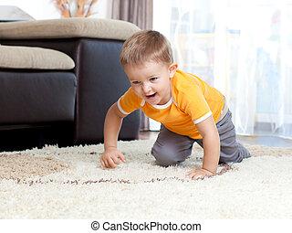cute cheerful crawling boy
