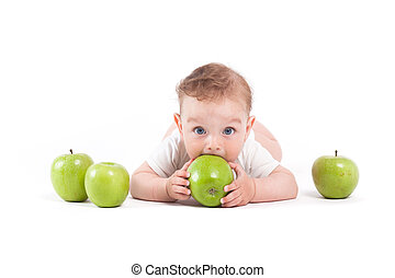 cute cheerful little boy in white shirt with apples
