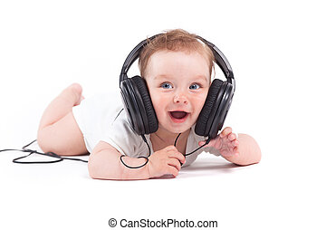 cute cheerful little boy in white shirt with headphones