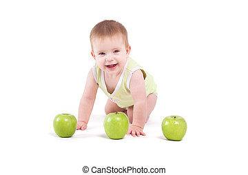 cute cheerful little boy with apples