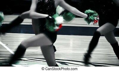 Cute cheerleaders performing before sports event