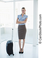 Cute chic businesswoman posing with