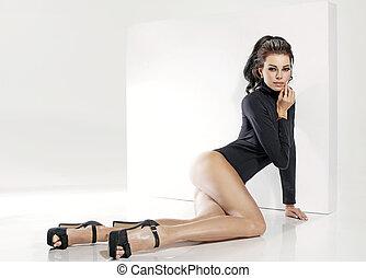 Cute chic lying in sensual pose - Cute young chic lying in...