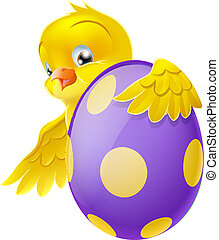 Cute chick and painted chocolate Ea - Cute Easter chick...