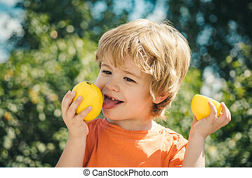 Cute child and lemon. Citrus fruits and vitamin C for health. Good health and strong children immunity. Vaccinations and healthy eating