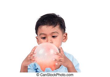 Cute child asian little boy blowing red balloon