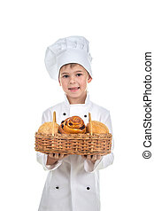 Cute Child Boy Bakery With Basket of Sesame and Raisin Buns, isolated on white