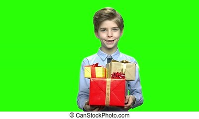 Cute child boy giving many gift boxes for your birthday....