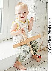 Cute child boy having fun at home