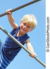 Cute Child Climbing at Playground