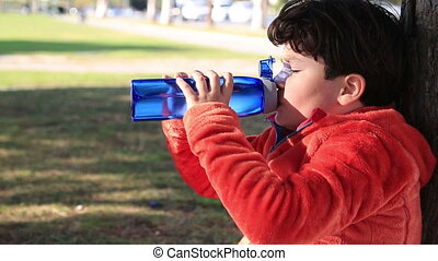Cute child drinking water
