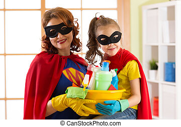 Cute Child Girl And Her Mother Make Cleaning The House. Little Girl And Mom  Are