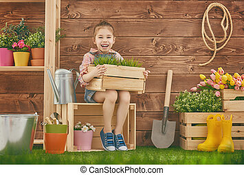 girl caring for her plants