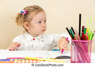 Cute child girl drawing with colorful pencils and felt-tip...