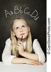 Cute Child Girl Learning Language on the Blackboard Background