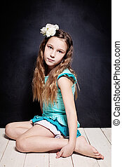 Cute Child Girl. Portrait of Young Teen on Dark Background