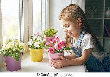 girl puts flowers