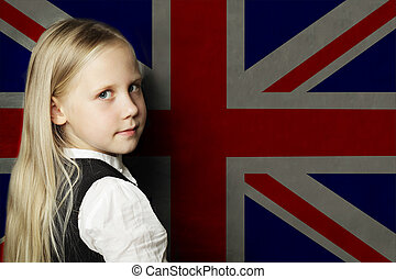 Cute child girl student against the UK flag background. English language school concept
