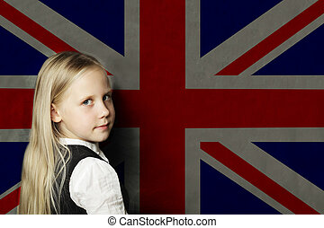 Cute child girl student with UK flag background. English language school concept