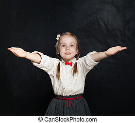 Cute child girl with hands up. Embrace. Happy girl 5 years old