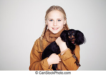 Cute Child Girl with Puppy