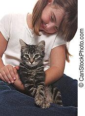 Child Holding a Kitten on White