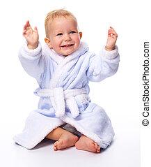 Cute child in bathrobe - Bright portrait of a cheerful child...