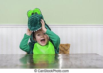 Cute child in crocodile suit