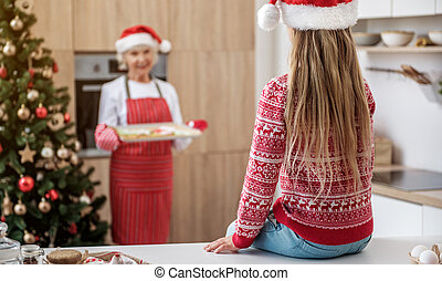 Cute child is in anticipation of Christmas cookies