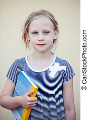 Cute child little girl with book on portrait
