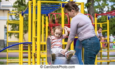 Cute Child On a Slide In Playground