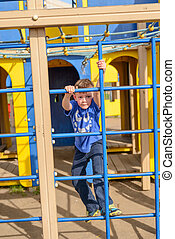Cute child peering from playhouse