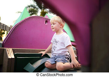 Cute Child Playing by Himself at Playground