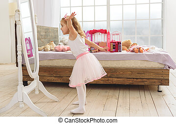 Cute child playing in her bedroom