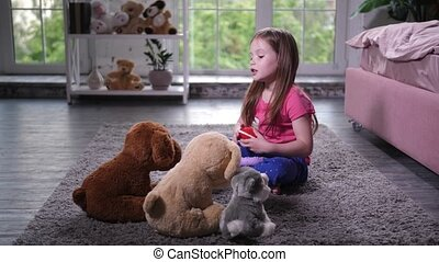 Cute child playing with teddy puppies in nursery - Playful...