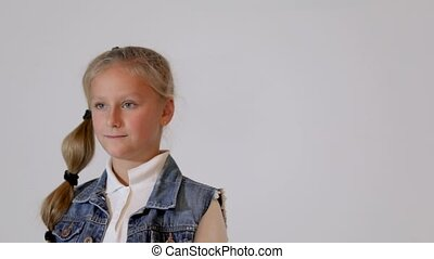 Cute child posing in the photo studio. - Cute little girl...