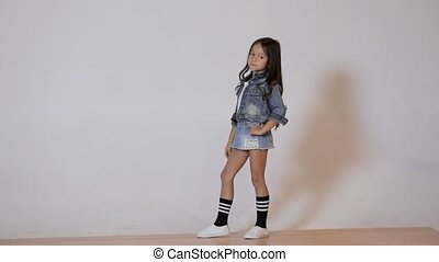 Cute child posing in the photo studio. - Cute little girl...