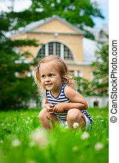 Cute child sitting in grass