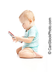 Cute child talking on a cell phone