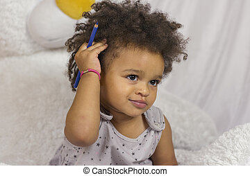 Cute child touching curly hair