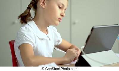 Cute child use laptop for education, online study, home ...