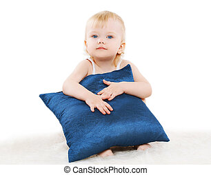 Cute child with a pillow on a white background