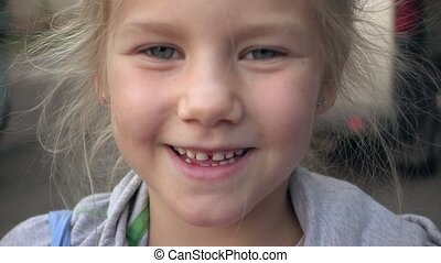 Cute child with big smile and blue eyes - Close up of cute...