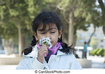 Cute child with flowers