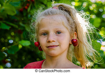 cute child with ripe healthy cherry fruit